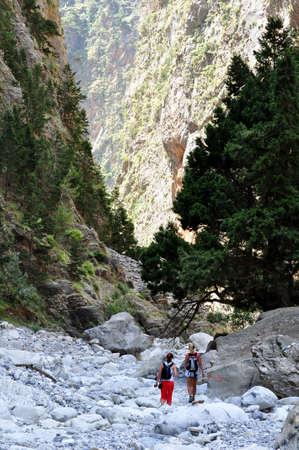 samaria: Samaria National Park, Crete. Two girls hiking towards the gorge.