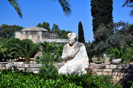 Travel Greece: marble roman statue and the Ayios Titos Basilica at Gortyn, Crete.