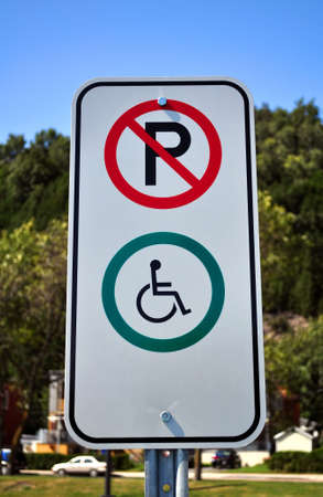 impaired: Handicapped reserved parking sign