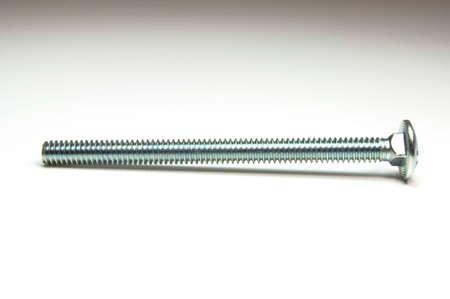Hoge resolutie foto van een geïsoleerde schroef. Stockfoto