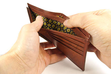 lack: No money concept. Hands holding an empty leather wallet. Stock Photo