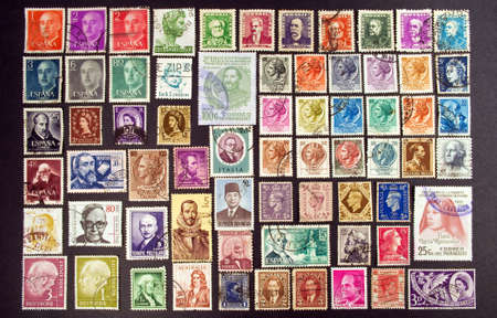 philately: Collection of stamps displaying faces from around the world.