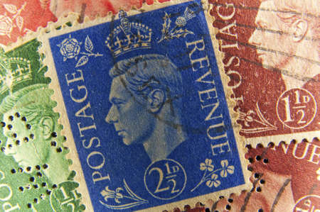 philately: Vintage postage stamps from United Kingdom, face of King George. Stock Photo