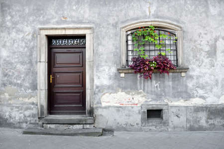 simple: Simple old house facade in Warsaw, Poland.