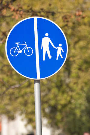 Give way, pedestrian and bicycle crossing sign. photo