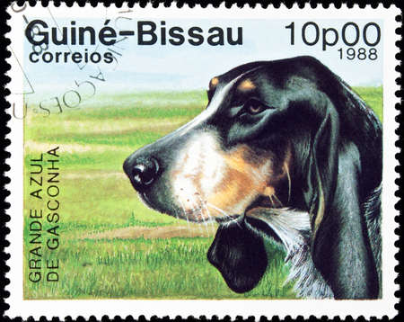 philately: GUINEA-BISSAU - circa 1988:postage stamp features a Grande Azul de Gasconha dog, circa 1988 in the Republic of Guinea-Bissau. Stock Photo