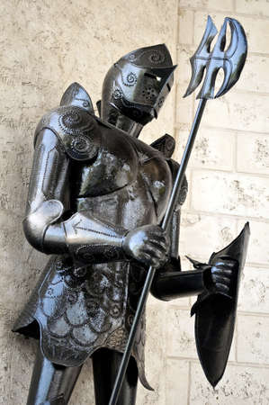 Image of a standing medieval knight armor.
