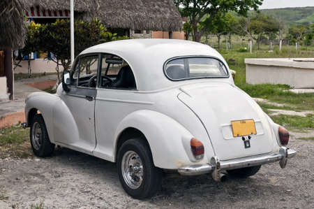 Vintage car shows signs of aging near Havana, Cuba.