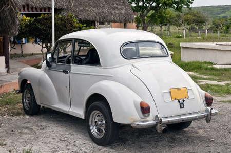 damaged: Vintage car shows signs of aging near Havana, Cuba.