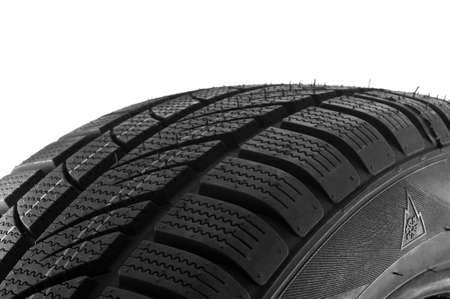 Winter tire close up on white background. photo