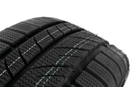 tire tread: Winter tire close up on white background.