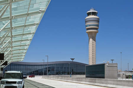 Modern airport terminal and air traffic control tower.