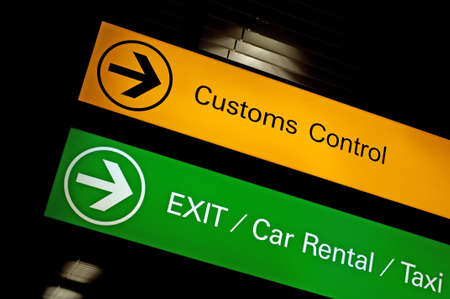 rental: Airport customs, exit, car rental and taxi sign.