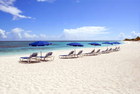 anguilla: Sunbeds and beach umbrellas at beautiful caribbean beach.
