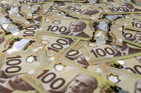 canadian currency: Close up view of new 100 Canadian dollar banknotes. Stock Photo