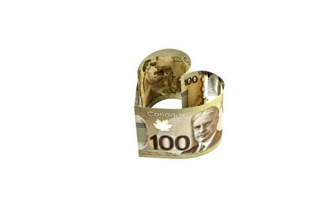 Isolated, heart-shaped, close up view of new 100 Canadian dollar banknote