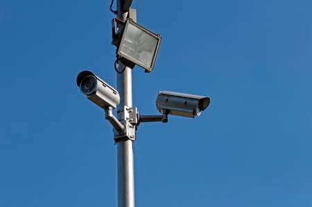 crime: Crime control  Two security cameras monitor a parking lot