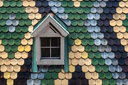 Detailed view of colorful roof shingles and window  photo