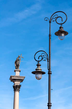 lampost: Street lamp and statue of Zygmunt III Vasa in Warsaw, Poland