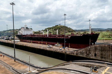 Transport ship at the Miraflores locks in Panama Canal, Panama. Stock Photo