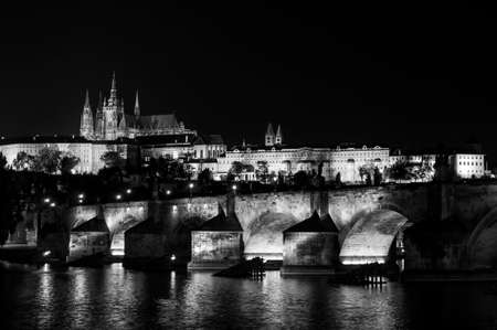 st charles: St. Vitus Cathedral and Charles bridge at night, Prague, Czech Republic. Black and white.