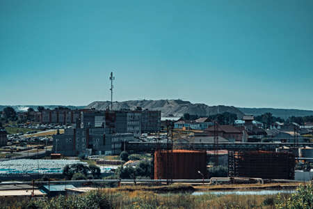 An industrial city in which salt mining is developed. In the background, large salt dumps, mountains of waste from salt production of potassium salt.
