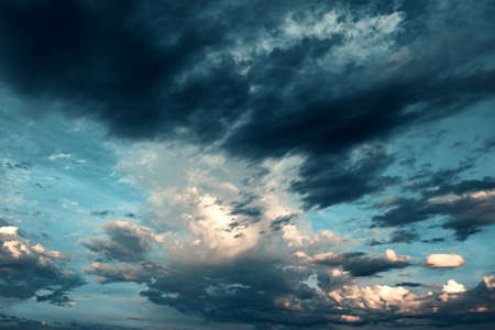 White volumetric magic clouds on the background of blue fantasy sky