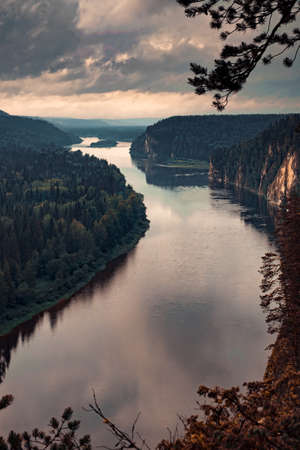 Landscape from the height of the winding river with a rocky shore Banco de Imagens