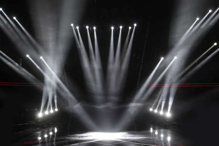 Spotlights in an empty stage Фото со стока