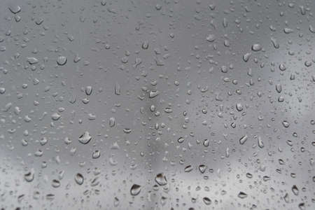 The drops of rain on a window, in Madrid, Spain