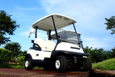 A brand new white golf cart in an exclusive Country Golf Club photo