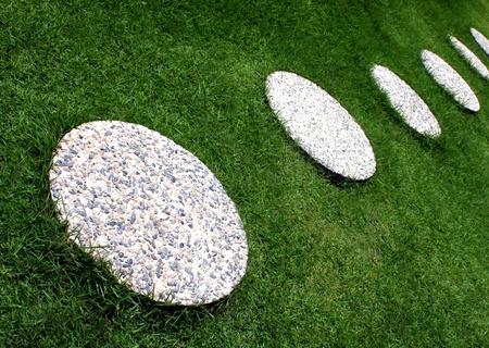 precast: Selected round concrete precast placed on a bermuda grasses for steps