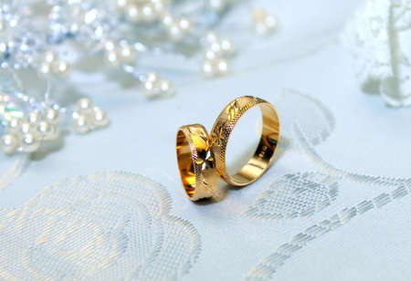 Authentic designed golden wedding rings for him and for her for eternal love  Stock Photo - 12702474