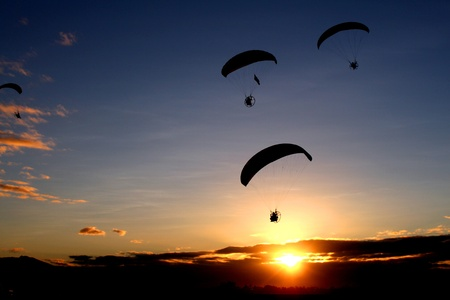 An early morning paragliding by the participants of the Annual Hot Air Balloon Fiesta in Angeles, Pampangga, Philippines