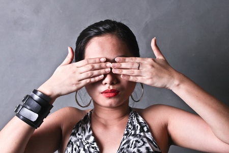 A young lady covering her eyes with both hands Stock Photo - 13366153