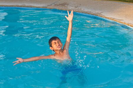 Swimming child showing his enjoyment in the water photo