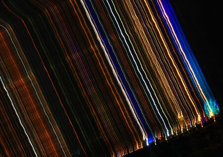 Burst of colorful striking line of lights on a jet black background photo