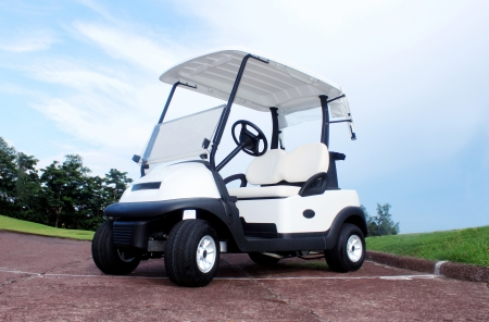 Golf cart is an electric vehicle designed originally to carry golfer s and their golf clubs for easy and less effort than walking around the golf course  photo