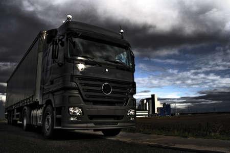 Truck in industrial landscape on dramatic HDR backgraound Standard-Bild