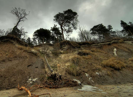 Baltic coast with eroded beach and landslide after storm with a touch of gentle HDR