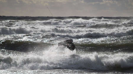 Kiteboarding event in Baltic sea during storm photo