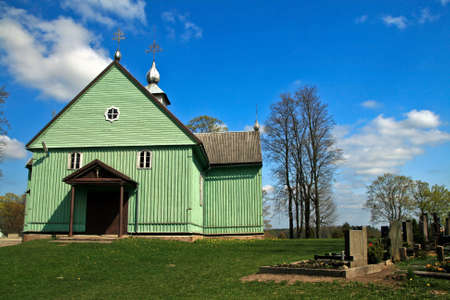 cemetry: Authentic wooden curch in Lithuania Eastern Europe near cemetry Stock Photo
