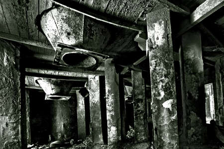 Abandoned spooky industrial room in former factory in HDRblack and white photo