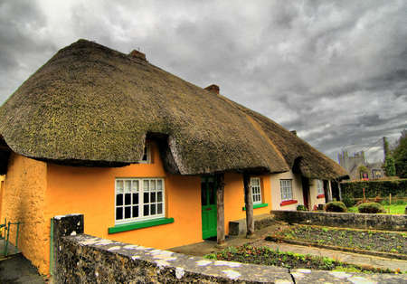 Typical old traditional Irish house with reed roof