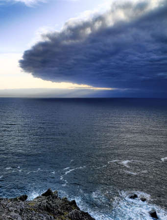 Approaching dramatic and dangerous front of cyclone at Irish seahore Stock Photo - 4955597