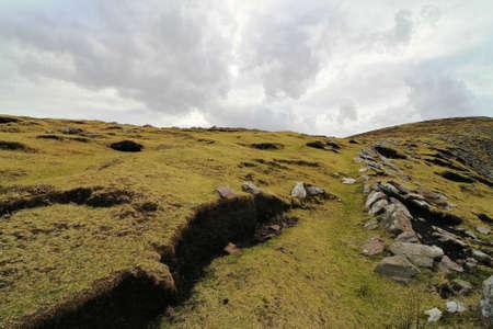 Typical Irish landscape on windy day in Dingle peninsula, Brandon head photo