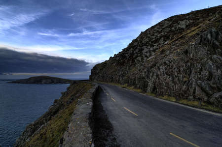 gaelic: Sunset on the road in Dingle peninsula coastline