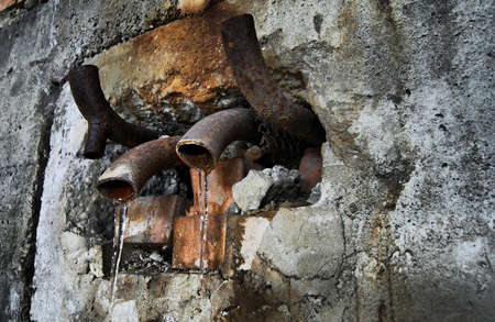 old piping at industrial decayed cite with frozen leakege Stock Photo - 5099101