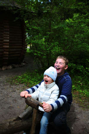 Boy and girl playing outdoors, happy and laughing Stock Photo - 5100595