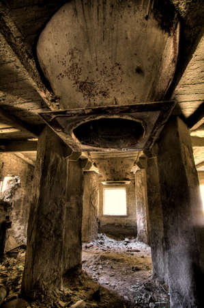 Empty industrial decayed room with large tube in the concrete wall Stock Photo - 5188527